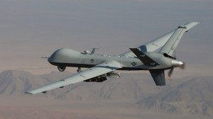 This undated handout photo provided by the U.S. Air Force shows a MQ-9 Reaper, armed with GBU-12 Paveway II laser guided munitions and AGM-114 Hellfire missiles, piloted by Col. Lex Turner during a combat mission over southern Afghanistan. (AP Photo/Lt. Col.. Leslie Pratt, US Air Force)