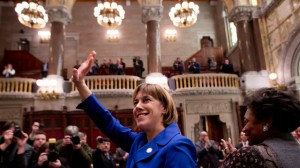 Sen. Cecilia Tkaczyk, D-Duanseburg, waves to the gallery after being sworn in to office in the Senate Chamber at the Capitol on Wednesday, Jan. 23, 2013, in Albany, N.Y. Campaign finance reform was central to Tkaczyk's campaign. (AP Photo/Mike Groll)