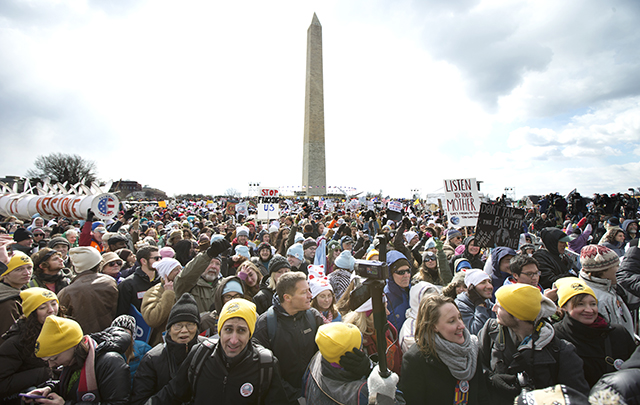 Thousands of protestors gather at the National Mall in Washington calling on President Barack Obama to reject the Keystone XL oil pipeline from Canada, as well as act to limit carbon pollution from power plants and '€œmove beyond'€ coal and natural gas, Sunday, Feb. 17, 2013. (AP Photo/Manuel Balce Ceneta)