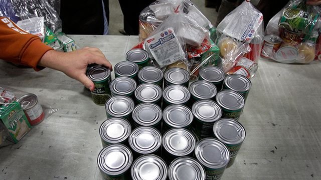 Volunteers fill bags with food for part of their backpack school lunch program at the Cleveland Foodbank in Cleveland on Tuesday, Nov. 22, 2011. The Foodbank provides take home lunches for school children on the days they do not have classes, and with the four-day holiday from school surrounding Thanksgiving, many more of the meals are needed. (AP Photo/Amy Sancetta)