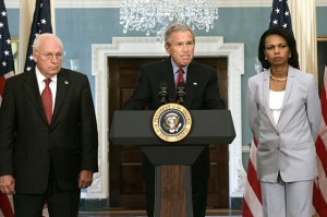 President Bush, center, pauses during remarks about the Middle East at the State Department on Monday, Aug. 14, 2006 in Washington.  From left is Vice President Dick Cheney, Bush and Secretary of State Condoleezza Rice.  (AP Photo/Evan Vucci)