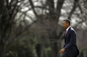 President Barack Obama walks across the South Lawn of the White House in Washington, Tuesday, March 5, 2013, before his departure on Marine One helicopter to Walter Reed National Military Medical Center and a visit with veterans who are being treated at the hospital and their families. (AP Photo/Pablo Martinez Monsivais)