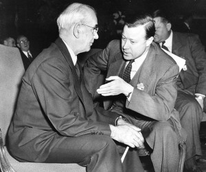Philip Murray, left, president of the Congress of Industrial Organizations (CIO), confers with Walter Reuther, president of the United Auto Workers, as the CIO National Convention opens in Chicago, Illinois, Nov. 20, 1950. (AP Photo)