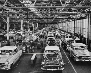 The final assembly line of this Plymouth plant in Detroit, seen on Aug. 13, 1954, is so vast that a visitor can walk about a half a mile without stepping outdoors. A division of Chrysler Corp., the Plymouth plant has twin assembly lines and is built entirely on one level covering 28 acres of floor space. It is capable of producing more automobiles in one day than any other plant in the world. (AP Photo/Chrysler Corporation)