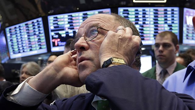 Trader Fred Reimer works on the floor of the New York Stock Exchange Wednesday, March 20, 2013. U.S. stocks rose strongly Wednesday ahead of a decision by the Federal Reserve about whether to push ahead with aggressive measures to boost the economy. (AP Photo/Richard Drew)