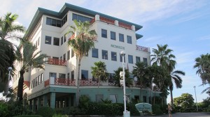 In this Aug. 3, 2012 photo, the Ugland House, the registered office for thousands of global companies, stands in George Town on Grand Cayman Island. (AP Photo/David McFadden)