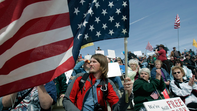 Patrick Will of Eaton, N.Y., holds an American flag during a tax day tea party rally in Albany, N.Y. (AP Photo/Mike Groll)