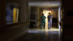 """In this Friday, June 8, 2012 photo, nurses walk under dimmed lighting during """"quiet time"""" at the Newborn Family Unit at the Massachusetts General Hospital in Boston. (AP Photo/Elise Amendola)"""