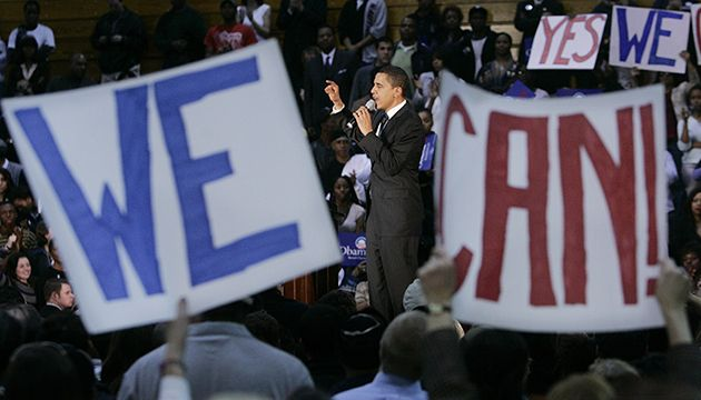"""Supporters hold up hand-painted signs as Democratic presidential hopeful Sen. Barack Obama, center, D-Ill., addresses a rally at Yanitelli Center on St. Peter's College campus in Jersey City, N.J., Wednesday Jan. 9, 2008. It is this way wherever Obama goes. Whenever Americans have been challenged, he tells them, there has been only one response. It comes back to him in a deafening roar that surges into a vibrating chant: """"YES WE CAN!"""" (AP Photo/Mel Evans)"""