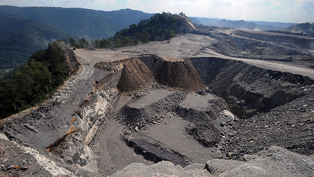 In this file photo, a mountaintop removal mining site at Kayford Mountain, W.Va. with Coal River Mountain, left, in the background. (AP Photo/Jeff Gentner, File)