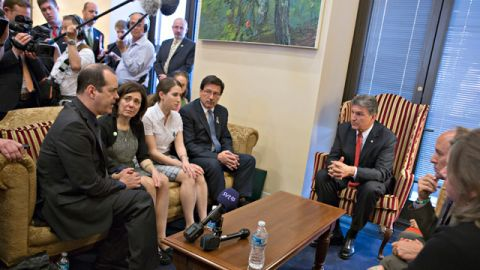 Sen. Joe Manchin, D-W.Va., seated right, meets in his office with families of victims of the Sandy Hook Elementary School shooting in Newtown, Conn. Seated on sofa from left are David and Francine Wheeler, who lost their 6-year-old son Ben in the shooting, Katy Sherlach and her father Bill Sherlach, whose wife Mary Sherlach was killed. At far right is Mark Barden, father of victim Daniel Barden. (AP Photo/J. Scott Applewhite)