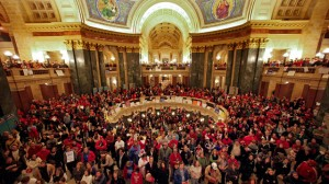 Protestors to Wisconsin Gov. Scott Walker's proposal to eliminate collective bargaining rights for many state workers listen in the rotunda at the State Capitol in Madison, Wis., Wednesday, Feb. 16, 2011, to testimony during a Joint Finance Committee meeting . (AP Photo/Andy Manis)