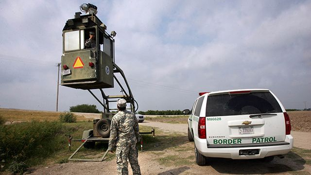 In this April 19, 2011, file photo, a member of the National Guard checks on his colleague inside a Border Patrol Skybox near the Hidalgo International Bridge in Hidalgo, Texas. National Guard members along the Texas-Mexico border assist Border Patrol by surveying the terrain from the tower.