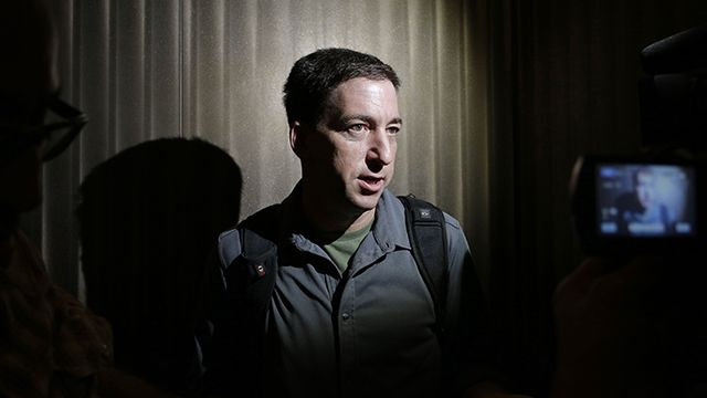 Glenn Greenwald, a reporter of The Guardian, speaks to reporters at his hotel in Hong Kong Monday, June 10, 2013. Greenwald reported a 29-year-old contractor who claims to have worked at the National Security Agency and the CIA allowed himself to be revealed Sunday as the source of disclosures about the U.S. government's secret surveillance programs, risking prosecution by the U.S. government. (AP Photo/Vincent Yu)