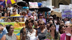Marjorie Hill, second left, CEO of the Gay Men's Health Crisis, address the Women for Paid Sick Days rally on the steps of New York's City Hall last summer. (AP Photo/Richard Drew)