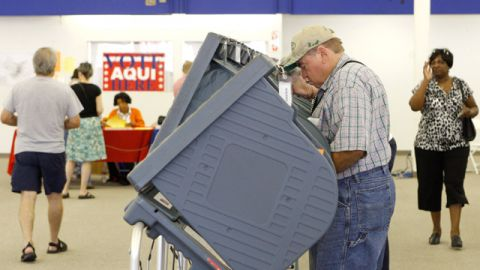 Voters arrive during the first day of early voting at a Travis County mega voting site in Austin, Texas, in 2008. (AP Photo/Harry Cabluck)