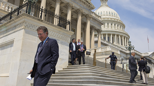 After final vote were cast, members of Congress walk down the steps of the House of Representatives as they leave for a five-week recess, at the Capitol in Washington, Friday, Aug. 2, 2013. With few accomplishments in the divided 113th Congress, the next big battle is over the budget, the nation's debt limit and the possibility of at least a partial government shutdown.  (AP Photo/J. Scott Applewhite)