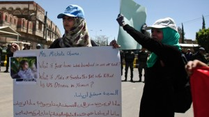 Yemeni women hold banners during a protest to denounce US drone attacks in Yemen, in front of US embassy in Sanaa, Yemen, Monday, April 29, 2013. (AP Photo/Hani Mohammed)