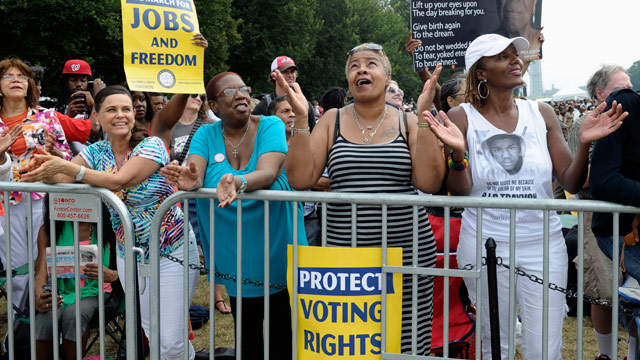 Allie Santiago of Houston, left, Brenda Reid of Bronx, N.Y., second from left, Caril Howard of North Chesterville, Va., and Jo Ann White Thompson of Goldsboro, N.C., listen to a musical performance during the March on Washington, Wednesday, Aug. 28, 2013, at the Lincoln Memorial in Washington. President Barack Obama will speak later Wednesday. (AP Photo/Susan Walsh)