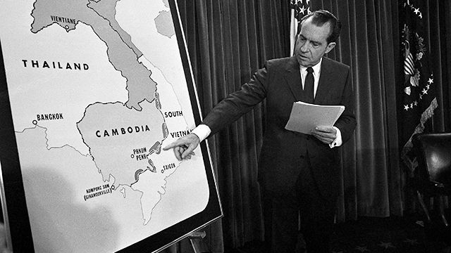 US President Richard Nixon poses in the White House after his announcement to the nation April 30, 1970 that American ground troops have attacked, at his order, a Communist complex in Cambodia. Nixon points to area of Vietnam and Cambodia in which the action is taking place. (AP Photo)