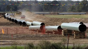 Large sections of pipe are shown on a neighboring property to Julia Trigg Crawford family farm on Oct. 4, 2012, in Sumner, Texas. Oil has long lived in harmony with farmland and cattle across the Texas landscape, a symbiosis nurtured by generations and built on an unspoken honor code that allowed agriculture to thrive while oil was extracted. (AP Photo/Tony Gutierrez)