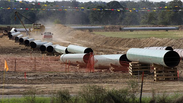 Large sections of pipe are shown on a neighboring property to Julia Trigg Crawford family farm Thursday, Oct. 4, 2012, in Sumner Texas. Oil has long lived in harmony with farmland and cattle across the Texas landscape, a symbiosis nurtured by generations and built on an unspoken honor code that allowed agriculture to thrive while oil was extracted. (AP Photo/Tony Gutierrez)