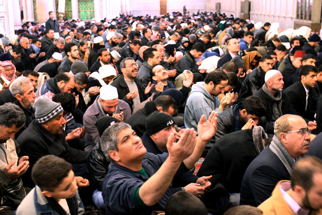 Thousands of Syrian Muslims pray for rain at the Grand Umayyad Mosque in central Damascus on Dec. 29, 2006 as Syria witnessed a period of drought that lasted some 50 days. Syria suffers water shortages especially in the capital Damascus due to the increased population in the past decade with limited water supplies. (AP Photo Bassem Tellawi).