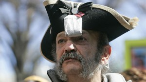Tea Party member Greg Hernandez, of Quicksburg, Va., wearing a tri-corner hat and tea bag. (AP Photo/Steve Helber)