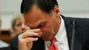 Richard S. Fuld, Jr., former Chairman and Chief Executive Officer of Lehman Brothers, wipes his eye during testimony before the House Financial Services Committee regarding financial reform on Capitol Hill in Washington, Tuesday, April 20, 2010. (AP Photo/Charles Dharapak)