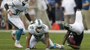 Houston Texans receiver DeAndre Hopkins, right, goes down and is injured during the first half of a preseason NFL football game, Saturday, Aug. 17, 2013. Hopkins, Houston's first-round pick, left the game with what the team says is a head injury. (AP Photo/Patric Schneider)