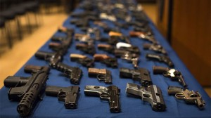 Nearly 100 confiscated illegal firearms rests on a table before a press conference with Mayor Michael Bloomberg, NYPD Police Commissioner Ray Kelly, and New York City District Attorney Cyrus Vance, Friday, Oct. 12, 2012 in New York. (AP Photo/John Minchillo)