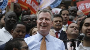 Democratic mayoral candidate Bill de Blasio smiles during a rally in the Brooklyn borough of New York, Thursday, Sept. 12, 2013. (AP Photo/Seth Wenig)
