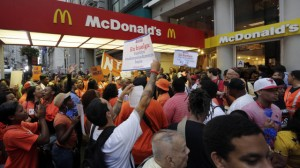 Protesting fast food workers demonstrate outside a McDonald's restaurant on New York's Fifth Avenue, Thursday, Aug. 29, 2013. (AP Photo/Richard Drew)