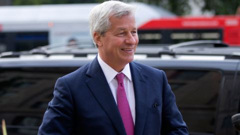 JPMorgan Chase Chairman, President and CEO Jamie Dimon, arrives at the Justice Department in Washington, Thursday, Sept. 26, 2013. An $11 billion national settlement is under discussion to resolve claims over JPMorgan's handling of mortgage-backed securities in the run-up to the recession, said a government official familiar with ongoing negotiations among bank, federal and New York state officials. (AP Photo/Manuel Balce Ceneta)