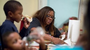 Jennifer Donald whose family receives money from the Supplemental Nutrition Assistance Program also know as food stamps, eats dinner with her sons David, 6, left, and Donovan, 4, in Philadelphia. (AP Photo/Matt Rourke)