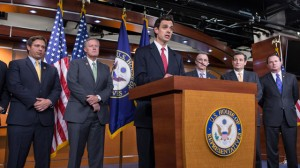 Rep. Tom Graves, R-Ga., center, speaks at a news conference with conservative Congressional Republicans who persuaded the House leadership to include defunding the Affordable Care Act in legislation to prevent a government shutdown at the end of the month, at the Capitol in Washington, Thursday, Sept. 19, 2013. From left to right are Rep. Ron DeSantis, R-Fla., Rep. Mark Meadows, R-NC, Rep. Tom Graves, R-Ga., Rep. Matt Salmon, R-Ariz., Sen. Ted Cruz, R-Texas, and Sen. Mike Lee, R-Utah. (AP Photo/J. Scott Applewhite)