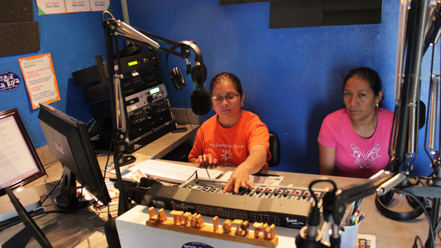 Two broadcasters at the Coalition of Immokalee Workers' Radio Conciencia, a worker-run radio station in Immokalee, Florida.