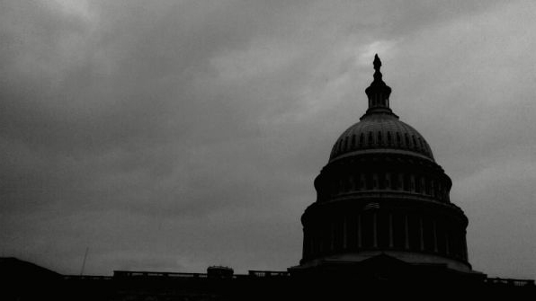 The Capitol building with storm clouds behind it