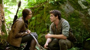 Jennifer Lawrence portrays Katniss Everdeen, left, and Liam Hemsworth portrays Gale Hawthorne in a scene from 'The Hunger Games.' (AP Photo/Lionsgate, Murray Close, File)