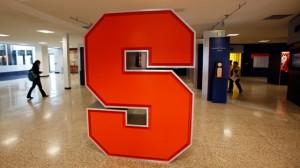 A Syracuse University logo is displayed inside the lobby of the Carmelo K. Anthony Basketball Center at Syracuse University in Syracuse, NY. (AP Photo/David Duprey)