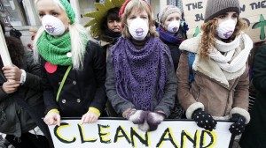 Young girls protest in front of the Polish Ministry of Economy in Warsaw, Monday Nov. 18, 2013 where a CoalIndustry meeting is taking place in Warsaw, Poland, Monday, Nov. 18, 2013. The U.N.'s chief climate diplomat on Monday urged the coal industry to diversify toward cleaner energy sources and leave most of the world's remaining coal reserves in the ground. On the sidelines of a U.N. climate conference, Christiana Figueres told dozens of CEOs of coal companies meeting at Poland's Economy Ministry that their industry needs to change radically to curb emissions of heat-trapping gases that scientists say are warming the planet. (AP Photo/Czarek Sokolowski)