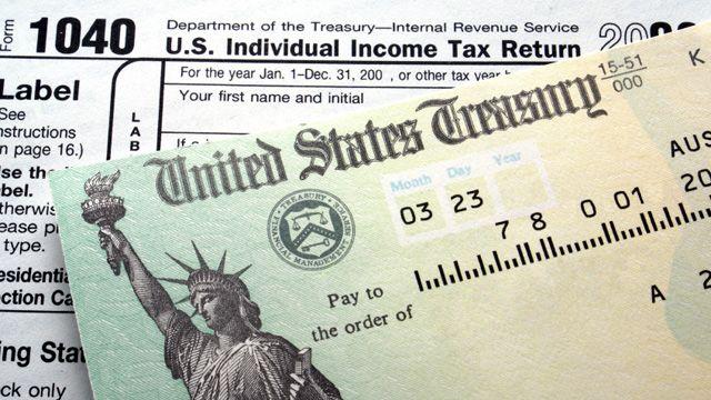 Photo of tax return and US treasury check