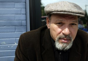 Pulitzer Prize-winning playwright August Wilson poses during a visit to a coffee shop in his Seattle neighborhood. (AP Photo/Ted S. Warren)