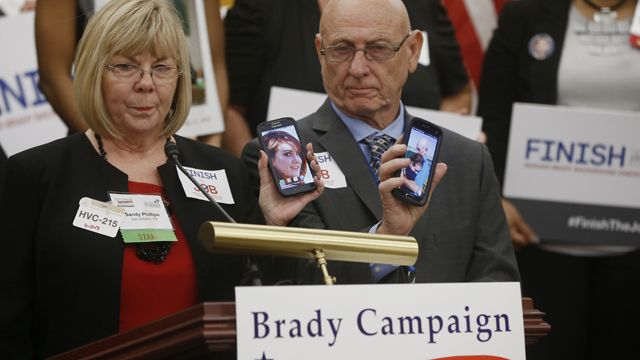 Sandy and Lonnie Phillips, from San Antonio, Texas, who lost their daughter Jessica Ghawi, 24, in the Aurora, Colo., movie theater shooting, shows a picture of their daughter. (AP Photo/Charles Dharapak)
