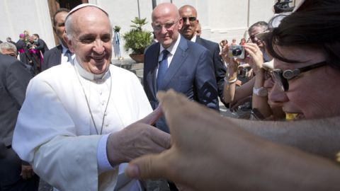 Pope Francis greets the faithful as he leaves the village of Castel Gandolfo, the pontiffs' summer residence in the hills overlooking Rome in August. (AP Photo/Andrew Medichini, File)