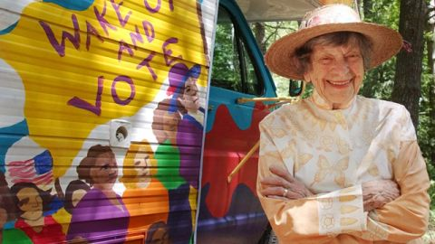 """Doris """"Granny D"""" Haddock poses Tuesday June 15, 2004 in Dublin, NH in front of the camper she used during her cross country walk to support campaign finance reform. (AP Photo/Jim Cole)"""