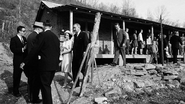 President Lyndon Johnson and his wife, Lady Bird, visit the Appalachian area in Eastern Kentucky to see conditions firsthand and announce his War on Poverty.