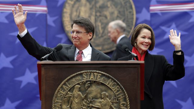 North Carolina Gov. Pat McCrory and his wife Ann greet the public prior to taking the oath of office during the inaugural ceremonies at the state capitol in Raleigh, NC, Saturday, Jan. 12, 2013. (AP Photo/Gerry Broome)
