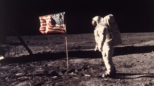 """Astronaut Edwin E. """"Buzz"""" Aldrin Jr.  poses for a photograph beside the US flag deployed on the moon during the Apollo 11 mission on July 20, 1969. (AP Photo/NASA/Neil A. Armstrong)"""