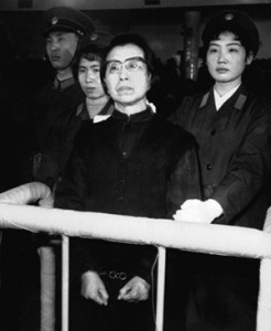 "Jiang Qing, the widow of Chinese leader Mao Tse-tung, stands handcuffed in the Supreme People's Court in Beijing, China during the Gang of Four trial. Jiang was sentenced to death for her role in China's failed Cultural Revolution; her sentence was suspended so that she might ""reform through labor."" (AP Photo/Xinhua)"